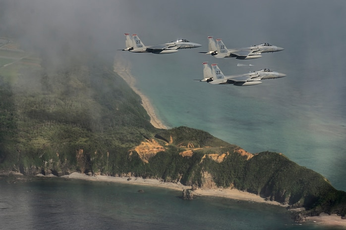 U.S. Air Force F-15 Eagles from the 67th Fighter Squadron fly a training mission over the Pacific Ocean outside of Kadena Air Base, Japan, Aug. 25, 2014. The 67th FS has been a part of Kadena's team since March 15, 1971, and provides air defense and air superiority in the Asian-Western Pacific area of operations. (U.S. Air Force photo by Staff Sgt. Stephany Richards/Released)