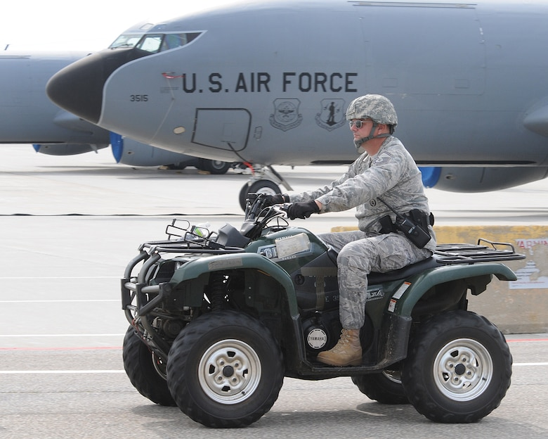 In this photo from August 2011, Chief Master Sergeant Michael P. Sullivan, then a senior master sergeant, rides an All-Terrain Vehicle along the flightline during a base readiness exercise on base. Sullivan, the 157th Security Forces Squadron manager, is scheduled to retire Oct. 1 during a ceremony Sept. 7 at 3:30 p.m. in Building 264urtis Lenz/Released)