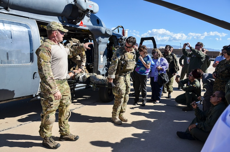 Pararescuemen from the 48th Rescue Squadron at Davis-Monthan Air Force Base, Ariz., demonstrate casualty care to dozens of military medical professionals from Latin American nations Aug. 28, 2014. Air Forces Southern hosted the Aerospace Medicine Symposium as a multinational key leader engagement designed to strengthen aerospace medicine departments in priority Central American countries by leveraging the knowledge and leadership of South American partner nations with the U.S. Air Force serving as a facilitator. This event builds upon previous engagements with partner nation countries and allows a maturation of their aerospace medicine doctrine, policy, program and operational medicine capacity. The aerospace medicine professionals have prior experience or are currently responsible for proving direct care to pilots, aircrew, or with moving patients through an aeromedical platform. In attendance were representatives from our partner nations Costa Rica, Panama, Guatemala, El Salvador, Honduras, Colombia, Peru, Chile, Uruguay, and Brazil. (U.S. Air Force photo by Tech. Sgt. Heather R. Redman/Released)