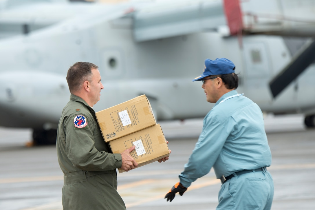 Maj. Destry Hill loads simulated relief supplies, Aug. 30, 2014, during the annual Tokyo Metropolitan Government Comprehensive Disaster Management Drill at Yokota Air Base, Japan. Yokota personnel practiced delivering simulated relief supplies to Ariake no Oka core wide-area disaster prevention base in downtown Tokyo.  Hill is a 5th Air Force UH-1N pilot. (U.S. Air Force photo/Osakabe Yasuo)