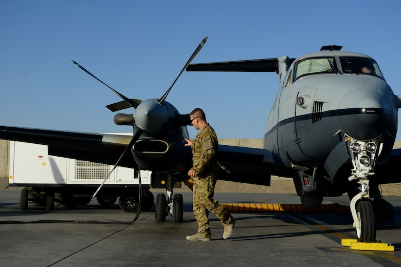 An Airman with the 361st Expeditionary Reconnaissance Squadron inspects an MC-12W Liberty Aug. 20, 2014, before a mission at Kandahar Airfield, Afghanistan. The squadron reached its end of mission in September after four years of operations in Afghanistan. (U.S. Air Force photo/Staff Sgt. Evelyn Chavez)