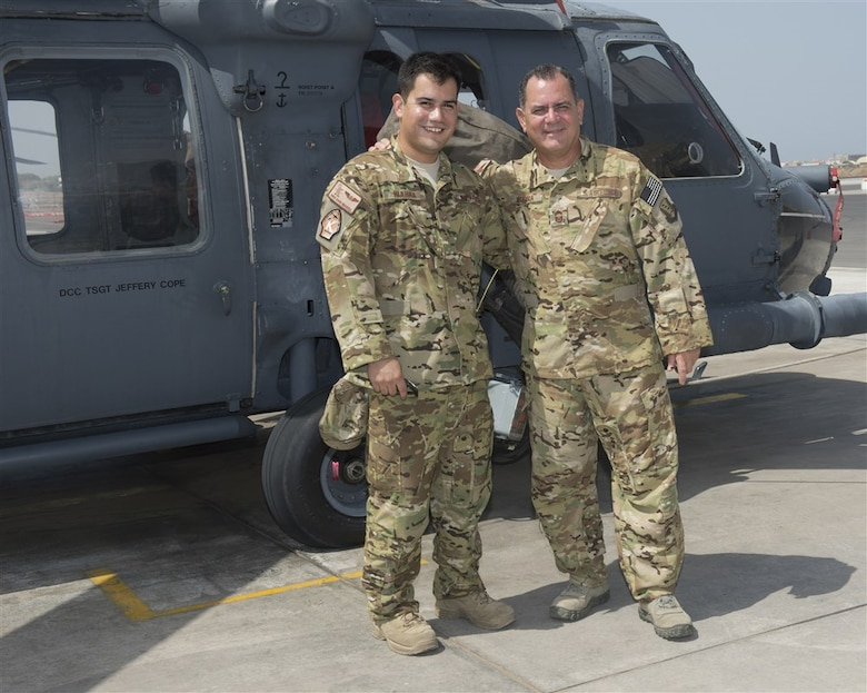 Senior Airman Daniel Ibarra, left, and Chief Master Sgt. Lazaro Ibarra pose in front of a HH-60G Pave Hawk helicopter Aug. 27, 2014, at Camp Lemonnier, Djibouti. The Ibarra's are a father and son deployed in support of Combined Joint Task Force-Horn of Africa from the 920th Rescue Wing, Patrick Air Force Base, Fla. Daniel is a loadmaster with the 81st Expeditionary Rescue Squadron and Chief Ibarra is a flight engineer with the 303rd ERQS. (U.S. Air Force photo/Staff Sgt. Leslie Keopka)