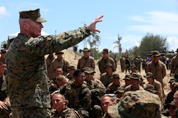 Lt. Gen. John Toolan, commander, U. S. Marine Corps Forces, Pacific, addresses the Marines with the 11th Marine Expeditionary Unit following the culminating joint amphibious demonstration of Malaysia-United States Amphibious Exercise 2014 at Kg Tanduo Beach, Malaysia, Sept. 2. MALUS AMPHEX 14 is a bilateral exercise between the 11th MEU and Malaysian Armed Forces that includes operational and tactical level training in planning, command and control, and combat service support using both ground and sea assets. (U.S. Marine Corps photo by Gunnery Sgt. Rome M. Lazarus/Released)