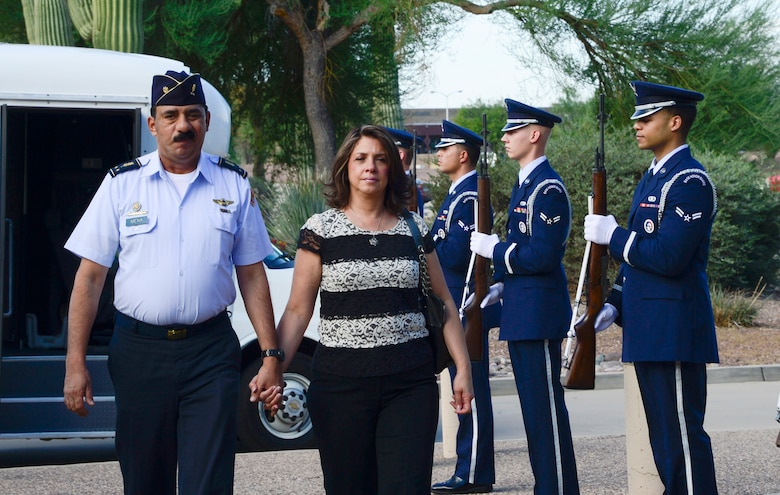 Brig. Gen. Carlos Mena, Chief of Staff of the El Salvadorian air force, and his wife Maria Mena walk through an honor cordon at 12th Air Force (Air Forces Southern), Davis-Monthan Air Force Base, Ariz., Sept. 3, 2014.  The El Salvadorian delegation was invited to visit AFSOUTH this week to discuss upcoming U.S. and El Salvadorian political-military integration subject matter expert exchanges. (USAF photo by Tech. Sgt. Heather R. Redman/Released)