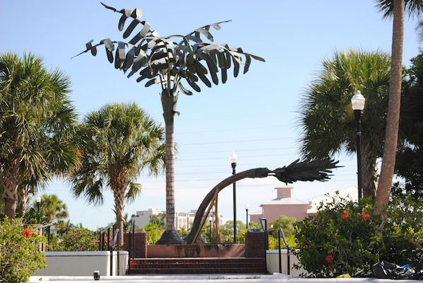 "A monument stands in downtown Punta Gorda paying homage to the resilience of the town in the face of Hurricane Charley.  ""The Spirit of Punta Gorda"" consists of two palm trees made of metal—one is bent to show the power of hurricane winds; the other is standing tall to show the strength of the people to survive the storm.  A sundial is also built into the structure, fixed on 4:29 p.m.—the moment when the downtown clock stopped as the storm struck."