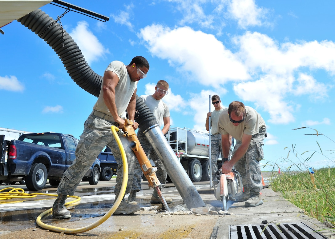 Airmen from the 633rd Civil Engineer Squadron repair sections of the runway Aug. 27, 2014, at Langley Air Force Base, Va. The improvements will provide a safe environment to sustain current flying operations and secure future mission capability. (U.S. Air Force photo/Senior Airman Connor Estes)
