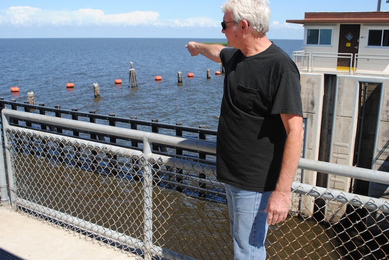 Port Mayaca Lock Operator Jon Fields points to the area where he discovered an injured manatee on March 15.  Fields made initial notification to authorities who later rescued the manatee and nursed it to health.