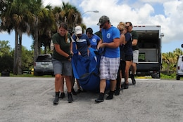 Staff with the Florida Fish & Wildlife Conservation Commission (FWC) release the rescued manatee back into the St. Lucie Canal on August 13 after it was nursed to health.