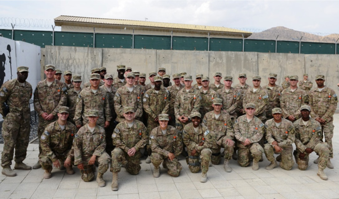 Members of the 439th Air Expeditionary Advisory Squadron security forces pose for a photo just after receiving Air Force Combat Action Medals during a ceremony  Sept. 2, 2014, at Forward Operating Base Oqab, Kabul, Afghanistan. The Airmen were recognized for actions defending FOB Oqab,  Afghan air force's Kabul Air Wing and a NATO base, all located on Kabul International Airport, from a complex attack July 17, 2014. (U.S. Air Force photo/Senior Master Sgt. Mike Hammond)