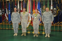 Sergeant Shane Fox and Sergeant George Grimm Jr. proved that Marines really are amphibious and won the basic water survival event on day one. From left to right: Command Sergeant Major Scott Dooley, 14th Military Police Brigade command Sergeant Major / Sergeant Fox / Sergeant Grimm / Col. Bryan Patridge, 14th Military Police Brigade commander.