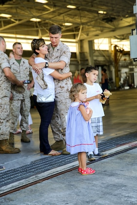 Sgt. Jeff Failing, an F/A-18 mechanic with Marine All-Weather Fighter Attack Squadron 533 and native of Denver, Colo., and his wife Gabriela Failing embrace as he prepares to deploy to the western pacific, Sept. 2. The deployment will help maintain relations with allied countries in the region.