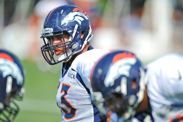 Ben Garland, Denver Broncos offensive guard, gets ready for the next drill during a training camp session Aug. 14, 2012, at the Broncos training facility in Englewood, Colo. Garland spent the 2012 season on the Broncos practice squad and transitioned from defensive tackle to offensive guard before the Broncos 2013 mini-camp. Garland is also a public affairs officer with the 140th Wing, Colorado Air National Guard, and served his annual commitment during the early part of 2013. (U.S. Air Force photo/Staff Sgt. Christopher Gross)