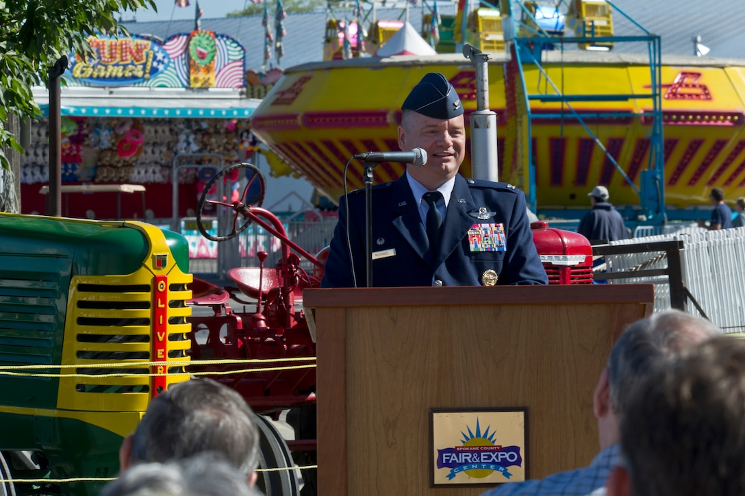 Col. Brian McDaniel, the 92nd Air Refueling Wing commander, gives opening remarks during the ribbon cutting ceremony to commemorate the opening of the Spokane Interstate Fair in Spokane, Washington, Sept. 5, 2014. Spokane County's Interstate Fair is a 10-day event beginning the Friday after Labor Day each year. The Fair is held at the Spokane County Fair and Expo Center on the corner of Broadway and Havana, its location since 1952. (U.S. Air Force photo by Staff Sgt. Alexandre Montes/Released)