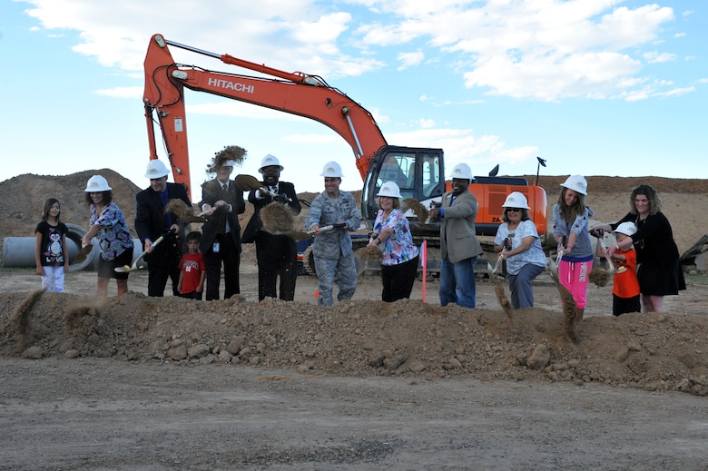 Students, parents, and base and community leaders break ground at the Aurora Public Schools Community Campus P-8 groundbreaking ceremony Sept. 3, 2014, in Aurora, Colorado. The new school will be just outside of Buckley's fence, benefitting the families and students of Team Buckley. (U.S. Air Force photo by Airman Emily E. Amyotte/Released)