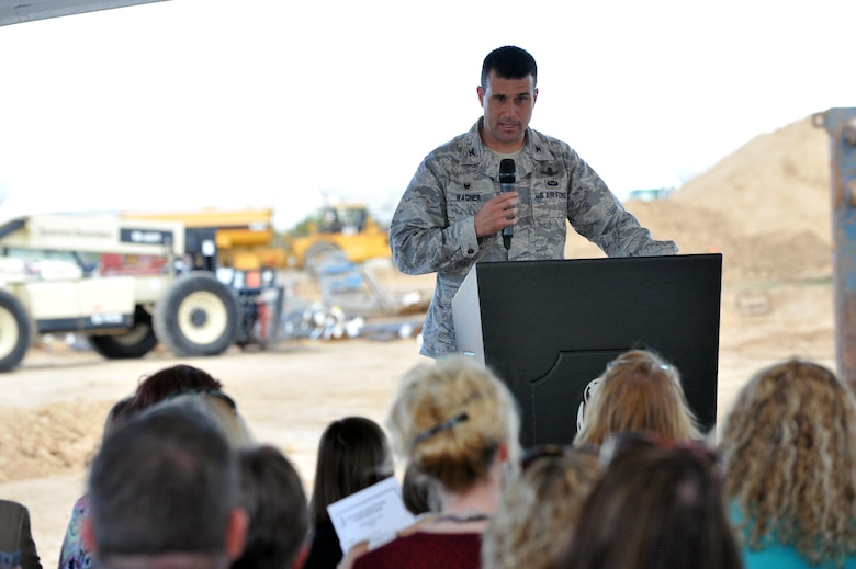 Col. John Wagner, 460th Space Wing commander speaks during the Aurora Public Schools Community Campus P-8 groundbreaking ceremony Sept. 3, 2014, in Aurora, Colorado. The new school will be just outside of Buckley's fence, benefitting the families and students of Team Buckley. (U.S. Air Force photo by Airman Emily E. Amyotte/Released)