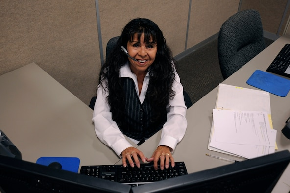Rebecca Terrones, an InDyne help desk technician, writes a help desk ticket for a customer, Sept. 5, 2014, Vandenberg Air Force Base, Calif. The communication focal point acts as the central hub for taking trouble calls, as well as monitoring all circuits and nodes on base. (U.S. Air Force photo by Airman 1st Class Ian Dudley/Released)