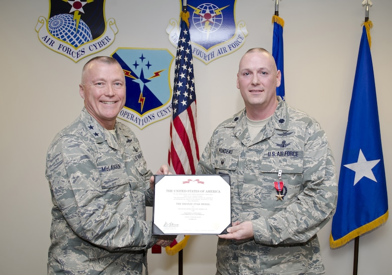 Maj. Gen. J. Kevin McLaughlin (Left), commander, 24th Air Force, presents the Bronze Star Medal to Lt. Col. William Rondeau (Right) at a medal ceremony July 25.  Rondeau was recognized for his role as 966th Air Expeditionary Squadron commander, part of the 9th Air And Space Expeditionary Task Force in Afghanistan.  (Courtesy Photo)