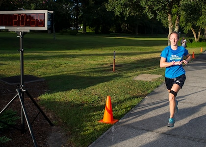Jessica Ramsey, spouse of 2nd Lt. Philip Ramsey, 628th Civil Engineer Squadron, finishes the 5k Fitness Challenge Sept. 5, 2014, at Joint Base Charleston, S.C. Ramsey was the first female finisher with a time of 20:35 and won a duffel bag filled with fitness items. More than 200 people participated in the run.  (U.S. Air Force photo/Staff Sgt. William O'Brien)