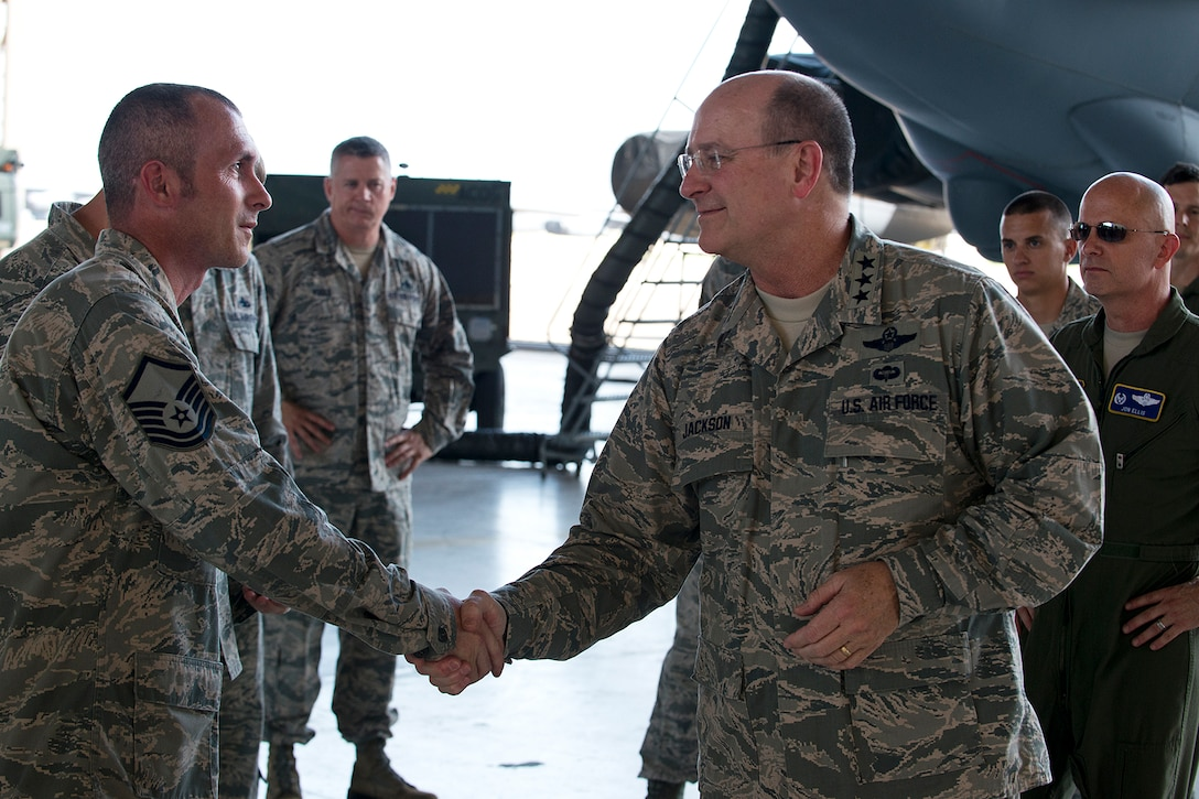 Lt. Gen. James Jackson, right, recognizes Master Sgt. James Hudson for his outstanding achievement as team chief of the Air Force Reserve's first nuclear-certified B-52 weapons load crew, Aug. 26, 2014, at Barksdale Air Force Base, La. Jackson's visit to Barksdale included a tour of the 307th Bomb Wing and then attending the Air Reserve Component focus day hosted by the Air Force Global Strike Command. Jackson is the commander of Air Force Reserve Command. (U.S. Air Force photo/Master Sgt. Greg Steele)