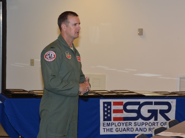 Col. Jeffrey Wiegand, 115 Fighter Wing commander, addressed approximately 70 employers and employees from the Madison area attended an Employer Support of the Guard and Reserve event Sept. 5 at the 115th FW, Madison, Wis.  Wiegand recognized employers who went above and beyond in their support of the Guard and Reserve members. (Air National Guard photo by Staff Sgt. Ryan Roth, released)