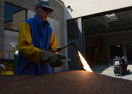 Senior Airman Andrew Bracken, structural journeyman assigned to the 175th Civil Engineering Squadron, Warfield Air National Guard Base, Baltimore, Md., lights an acetylene torch in preparation for a demonstration in raw cutting steel for fabrication purposes, September 6, 2014.  In addition to serving with the Maryland Air National Guard Bracken also volunteers his time with the Dallastown Volunteer Fire Department. (Air National Guard photo by Tech. Sgt. Christopher Schepers/RELEASED)