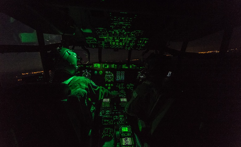 U.S. Air Force Capt. Scott Vander Ploeg, left, and 1st Lt. Trey Cecil, 37th Airlift Squadron pilots fly a 37th AS C-130J Super Hercules during an airdrop of paratroopers from the 1st Battalion, 503rd Infantry Regiment, 173rd Airborne Brigade during exercise Steadfast Javelin II over Lithuania, Sept. 5, 2014. The exercise prepares U.S., NATO Allies and European security partners to conduct unified land operations through the simultaneous combination of offensive, defensive, and stability operations appropriate to the mission and the environment, and to sustain interoperability with partner nations. (U.S. Air Force photo/Airman 1st Class Jordan Castelan)