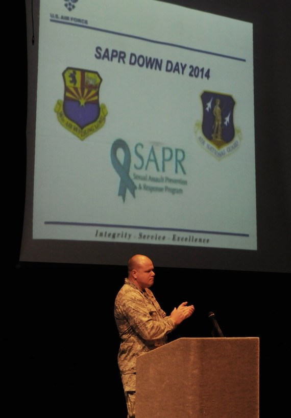 """Col. Gary D. Brewer, Jr., 161st Air Refueling Wing commander, briefs members from the Arizona Air National Guard gather at South Mountain High School, Phoenix, for the annual for SAPR Down Day during September's drill, Sept. 6, 2014. The Sexual Assault Prevention and Response [SAPR] program involved a full day of training to include briefs from the Adjutant General, the 161st Air Refueling Wing Commander, the Phoenix Police Department, and a trauma healing manager, as well as small group breakout sessions in the afternoon. """"…We need to hold people accountable and if they can't adapt and do what's right, if they can't live with integrity, put service before self and have excellence in all they do, they need to be gone."""" (Air National Guard Photo by Tech. Sgt. Courtney Enos/Released)"""