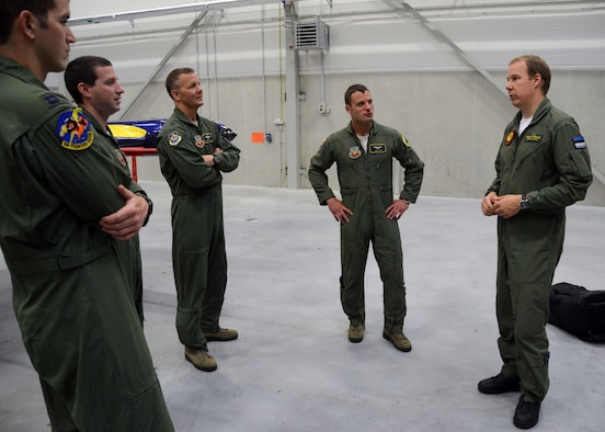 Captain Daniel Griffin, left, an A-10C pilot with Maryland Air National Guard, listens to Estonian Air Force Capt. Kalev Piirisild addresses a group of pilots assigned 