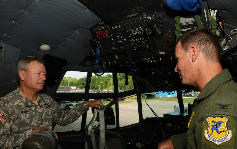 Col. Frank Detorie, commander of the 103rd Airlift Wing, and Gen. Frank J. Grass, Chief of the National Guard Bureau, tour a C-130H Hercules aircraft assigned to the 103rd Airlift Wing, Sept. 6, 2014, at Bradley Air National Guard Base, East Granby, Conn. Grass toured the base and met with Conn. Airmen during a town hall meeting. (U.S. Air National Guard photo by Senior Airman Jennifer Pierce)