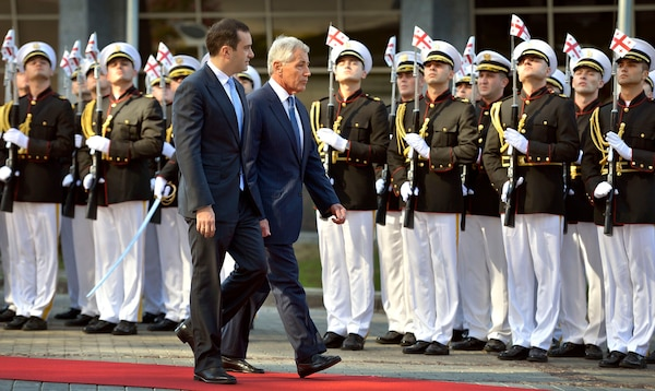 Secretary of Defense Chuck Hagel is escorted past an honor cordon by Georgian Minister of Defense Irakli Alasania during a ceremony welcoming Hagel to the defense ministry in Tbilisi, Georgia, Sept. 7, 2014. DoD Photo by Glenn Fawcett