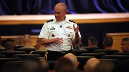 Chairman of the Joint Chiefs of Staff Gen. Martin Dempsey answers a question during a town hall meeting with Marines, sailors and former service members aboard Naval Station Great Lakes, Ill., Sept. 5. Dempsey discussed a wide range of topics including involvement in the Middle East, and how budget cuts affect service members worldwide.