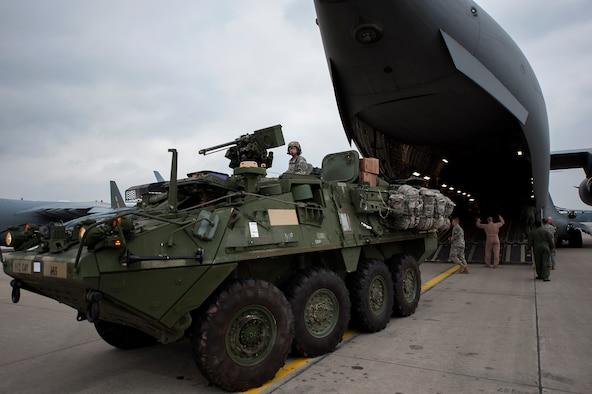 An Army Stryker assigned to the 2nd Cavalry Regiment, off loads from a C-17 Globemaster III in support of Steadfast Javelin II on Ramstein Air Base, Germany, Sept. 4, 2014. Steadfast Javelin II is a NATO exercise involving over 2,000 troops and takes place across Estonia, Germany, Latvia, Lithuania and Poland. (U.S. Air Force photo/Senior Airman Damon Kasberg)