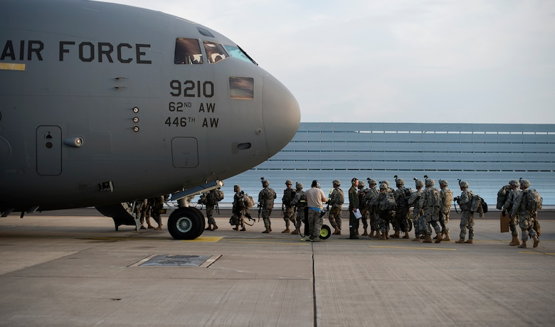 Soldiers assigned to Apache Troop, 1st Squadron, 2nd Cavalry Regiment load into a C-17 Globemaster III in support of Steadfast Javelin II on Ramstein Air Base, Germany, Sept. 5, 2014. Steadfast Javelin II is a NATO exercise involving over 2,000 troops and takes place across Estonia, Germany, Latvia, Lithuania and Poland. (U.S. Air Force photo/Senior Airman Damon Kasberg)
