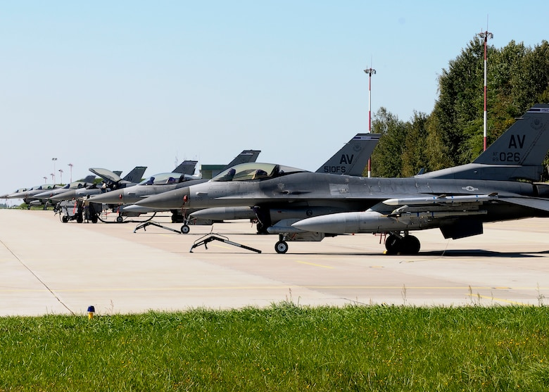 F-16 Fighting Falcons sit on the ramp Sept. 5, 2014, at Lask Air Base Poland. The F-16s and approximately 150 support personnel from the 31st Fighter Wing at Aviano Air Base, Italy, arrived at the U.S. Air Force Aviation Detachment to participate in bilateral training with Poland. The F-16s are assigned to the 510th Fighter Squadron. (U.S. Air Force Photo/Tech. Sgt. Eric Donner)