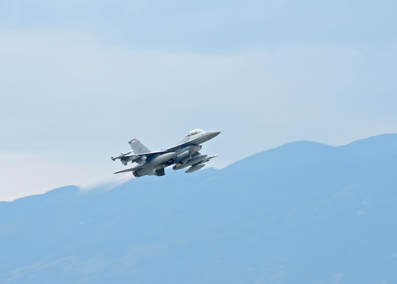 An F-16 Fighting Falcon takes off for Poland, Sept. 5, 2014, at Aviano Air Base, Italy. The 31st Fighter Wing is participating in a joint training exercise, Ample Strike, to expand upon ongoing efforts to build partnerships and interoperability in Europe. The F-16 is assigned to the 510th Fighter Squadron. (U.S. Air Force Photo/Staff Sgt. Jessica Hines)