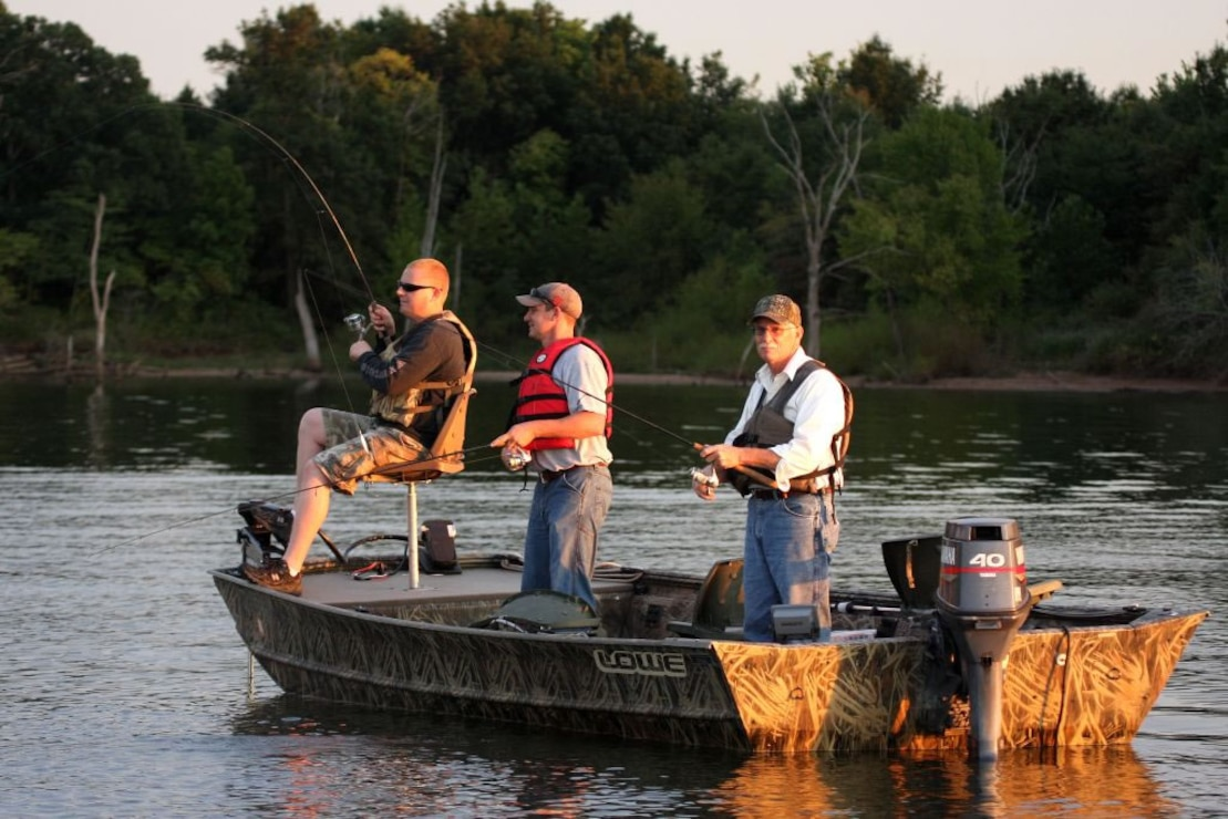 "Three anglers fish for ""the big one"" on Old Hickory Lake. (Photo by John Baird)"