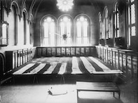 Flag which floated over Fort McHenry [in 1814], displayed horizontally in a room surrounded by cases, 4 June 1914.