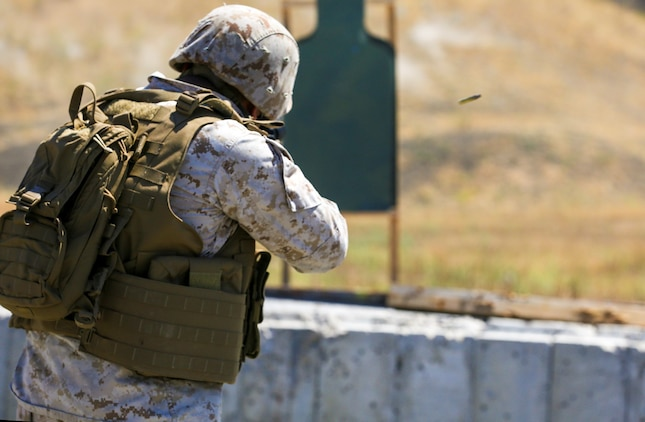 Corporal Alberto Perez III engages his target during a table three shoot aboard Marine Corps Base Camp Pendleton, Calif., Sept. 4, 2014. Table three is part of the Combat Marksmanship Program, which is designed to keep Marines in a combat mindset and ready for what the mission might demand. Perez is an administration specialist with the 15th Marine Expeditionary Unit. (U.S. Marine Corps photo by Cpl. Anna Albrecht/Released)