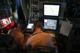Capt. Mike Jordan, left, and Capt. Craig Fitzhugh operate the Harvest Hercules Airborne Weapons Kit system in a modified KC-130J Super Hercules at Marine Corps Air Station Cherry Point, N.C., Sept. 2, 2014. The Harvest HAWK comes equipped with both Hellfire and Griffin missiles to provide close-air support for Marines on the ground. Jordan and Fitzhugh are both KC-130J pilots with Marine Aerial Refueler Transport Squadron 252.