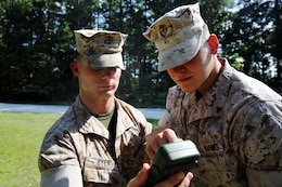 Lance Cpl. Joshua Byer, left, and Lance Cpl. Justin Goodchild use a Defense Advanced GPS Receiver to check a heading during a land navigation test at Marine Corps Air Station Cherry Point, N.C., Sept. 3, 2014. Byer and Goodchild are both gunners with 2nd Low Altitude Air Defense Battalion, practicing their land navigation skills during team leaders course. Byer is a native of Columbus, Ohio and Goodchild is a native of Longwood, Fla.