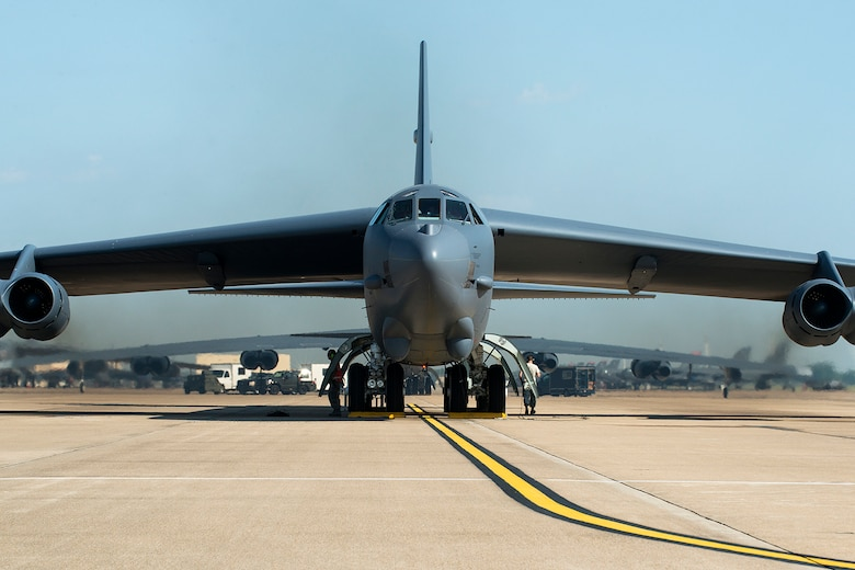 A 307th Bomb Wing B-52H Stratofortress runs up its engines prior to leaving for a mission on Aug. 28, 2014, Barksdale Air Force Base, La. On board the aircraft is Col. William Lyons, Assistant Vice Commander and the Director of Staff for 10th Air Force, who visited the 307th BW and flew his first flight in a B-52. (U.S. Air Force photo by Master Sgt. Greg Steele/Released)