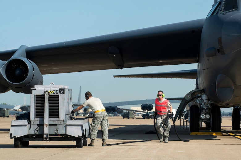 U.S. Air Force Tech. Sgt. Bryan Fields (right) and Airman 1st Class Justin Wharff, 2nd Aircraft Maintenance Squadron crew chiefs, disconnect an external power unit from a 307th Bomb Wing (BW) B-52H Stratofortress prior to a mission on Aug. 28, 2014, Barksdale Air Force Base, La. On board the aircraft is Col. William Lyons, Assistant Vice Commander and the Director of Staff for 10th Air Force, who visited the 307th BW and flew his first flight in a B-52. (U.S. Air Force photo by Master Sgt. Greg Steele/Released)