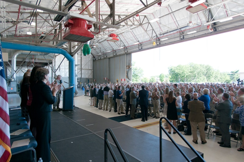 New Hampshire congressional delegates, leadership and former members of the 157th Air Refueling Wing applaud the hard work and professionalism of the airmen of the wing during a KC-46A selection celebration, Pease Air National Guard Base, N.H., Sept. 7, 2014. Pease was selected as the preferred alternative in May 2013 and announed as the main operating base Aug. 8 after the Air Force completed the environmental analysis required by the National Environmental Protection Act to provide further information concerning the basing process. (Air National Guard photo by Tech. Sgt. Aaron Vezeau/Released)