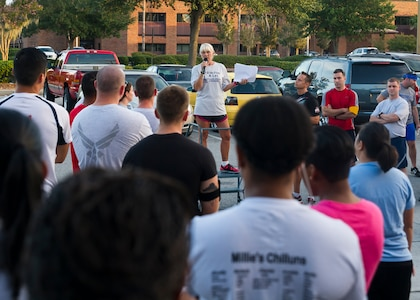 Gail Meminger Rush speaks before a Run for A Life 5K Sept. 5, 2014, at Joint Base Charleston S.C. Rush lost her daughter to suicide in Jan. 3, 2012. She spoke on topics of resiliency and suicide awareness. (U.S. Air Force photo/Staff Sgt. William O'Brien)