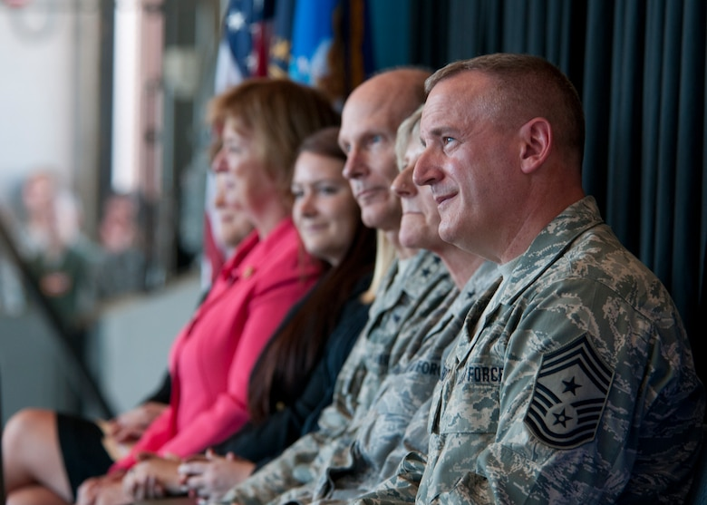 157 Air Refueling Wing Command Chief Master Sergeant Jamie Lawrence sits alongside wing senior staff and members of New Hampshire's congressional delegation during the KC-46 selection celebration, Pease Air National Guard Base, N.H. Sept. 7, 2014.  (U.S. Air National Guard photo by Staff Sgt. Curtis J. Lenz)