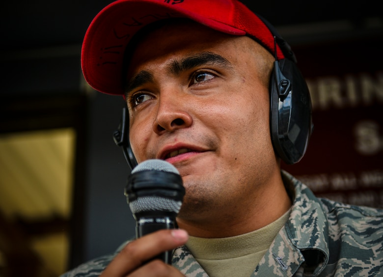 Senior Airman Enrique Salas, 39th Security Forces Squadron combat arms training and maintenance instructor, gives commands during the firing portion of a combat arms class Sept. 4, 2014, Incirlik Air Base, Turkey.  Combat arms instructors teach weapons qualifications for situations such as permanent change of station, deployments and to keep Airmen fresh in their weapons skills.  (U.S. Air Force photo by Senior Airman Nicole Sikorski/Released)