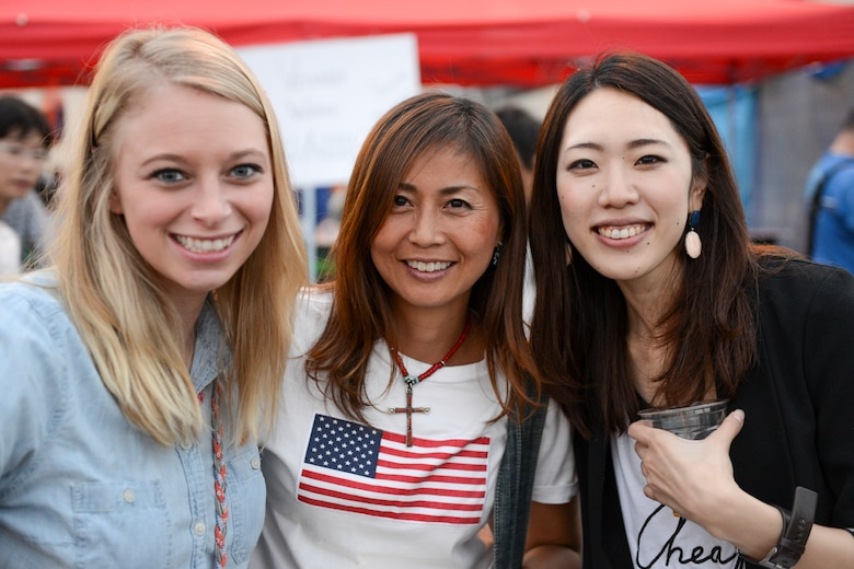 Friends pose for a photo together during the 2014 Japanese-American Friendship Festival at Yokota Air Base, Japan, Sept. 7, 2014. More than 148,000 people attended this year's festival. (U.S. Air Force photo by Staff Sgt. Cody H. Ramirez/Released)