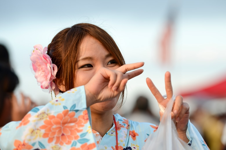 A woman wearing a traditional Japanese kimono poses for a photo during the 2014 Japanese-American Friendship Festival at Yokota Air Base, Japan, Sept. 7, 2014. During the two-day festival, Yokota hosted more than 148,000 attendees. The festival featured a variety of U.S. and Japanese military aircraft and offered an array of food booths and multicultural entertainment. (U.S. Air Force photo by Staff Sgt. Cody H. Ramirez/Released)