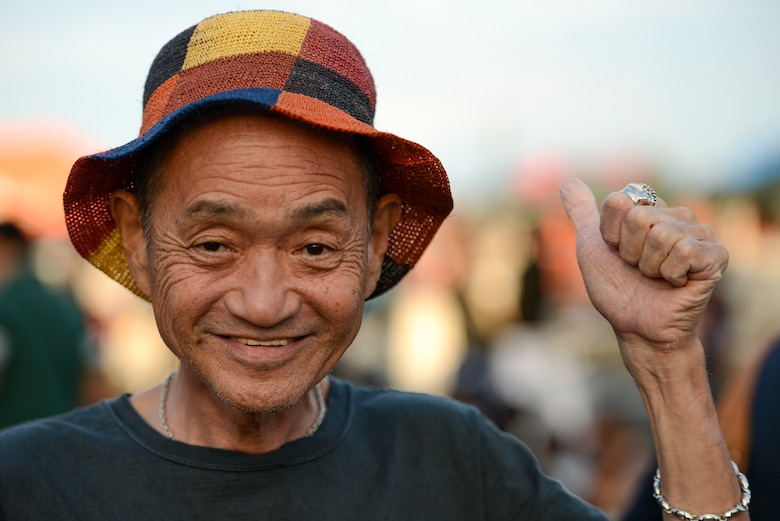 A man gives a 'thumbs-up' to show his excitement during the 2014 Japanese American Friendship Festival at Yokota Air Base, Japan, Sept. 7, 2014. During the two-day festival, Yokota hosted more than 148,000 attendees. The festival featured a variety of U.S. and Japanese military aircraft and offered an array of food booths and multicultural entertainment. (U.S. Air Force photo by Staff Sgt. Cody H. Ramirez/Released)
