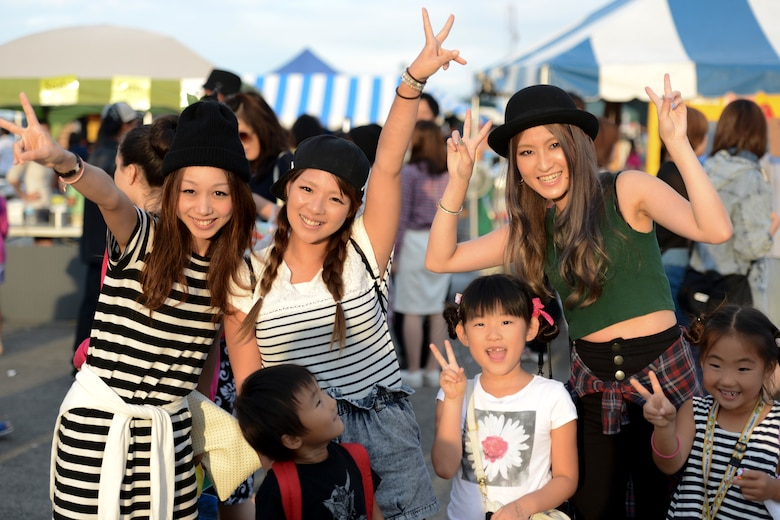 Festival goers poses for a picture during the 2014 Japanese-American Friendship Festival at Yokota Air Base, Japan, Sept. 7, 2014. More than 148,000 people attended this year's festival. (U.S. Air Force photo by Staff Sgt. Cody H. Ramirez/Released)